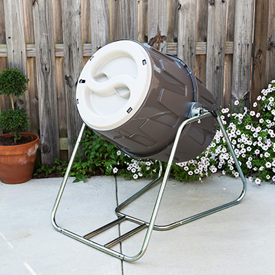 SUNCAST<sup>®</sup> Tumbling Composter - Go green and nourish your garden and flower bed with this standing, tumbling composter. This composter has 6.5 cubic feet of capacity, features dual lids for easy fill and emptying, spring-loaded lock that maintains its position when loading and unloading and sits on a sturdy galvanized steel frame.  Assembled size is 30.5