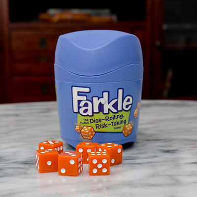 FARKLE™ Dice Game - Become a Farkle Fanatic™ with this dice-rolling, risk-taking game.  Take a risk, or play it safe in this fun game of strategy and luck. Game includes 6 dice, dice cup with lid and rules.  For 2 or more players, ages 8+.