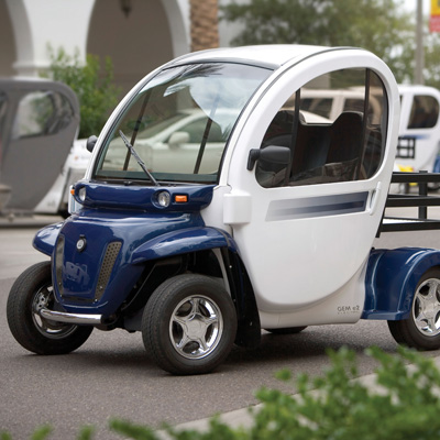 GEM<sup>®</sup> e2 Electric Car - Economic and environmentally friendly, this two-passenger vehicle is ideal for the short trips you make every day. Six 12-volt flooded electrolyte batteries provide a range of up to 35 miles on a charge.